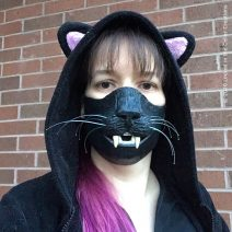 This highly detailed mask has glossy cat teeth and whiskers!